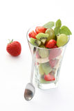 Fruity salad. Delicious fruity salad in glass on white background Stock Photos