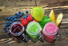 Fruity smoothie on a wooden table. Fruit to create smoothies. stock photo