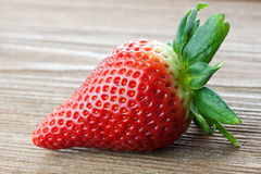 Fruity strawberry. Ripe red strawberry on a wooden table Stock Photo
