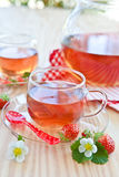 Fruity tea with strawberries Royalty Free Stock Photos
