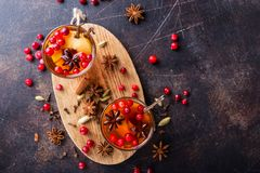 Fruity tea with vanilla ans other spices. Glasses of warm cranberry tea with various spices shot from above stock image