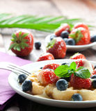 Fruity waffle. Waffle with strawberries and bilberries Royalty Free Stock Photos
