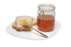 Frukost med rostat bröd två och ny honung Royaltyfri Fotografi