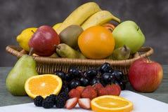 frukt för 3 korg Arkivbild
