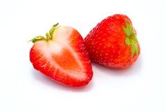 Frukt för två jordgubbar som isoleras på vit bakgrund arkivbilder