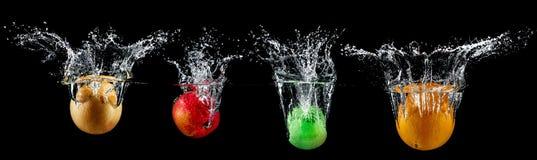 Frukt i vattenfärgstänk arkivfoton