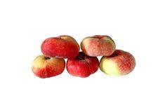 Frukter av de isolerade plana persikorna Arkivbilder