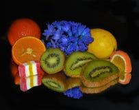 Frukter och candys Arkivfoto