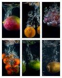 Frukter och grönsaker som faller in i vattnet Royaltyfria Bilder