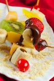 Frukter och smältt choklad Royaltyfria Bilder