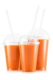 Fruktsaft i format tre av den plast- koppen royaltyfria foton