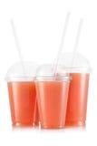 Fruktsaft i format tre av den plast- koppen fotografering för bildbyråer