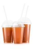 Fruktsaft i format tre av den plast- koppen arkivfoton