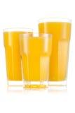 Fruktsaft i format tre av exponeringsglas arkivbilder