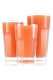 Fruktsaft i format tre av exponeringsglas royaltyfria foton