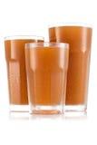 Fruktsaft i format tre av exponeringsglas arkivfoto