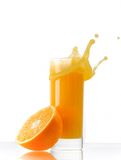 fruktsaftorangefärgstänk Arkivfoto