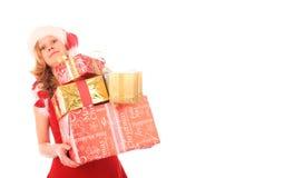 Fräulein Sankt trägt zu viele Geschenke Stockbilder