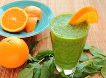 Frullato dell'arancia e degli spinaci Immagine Stock