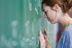 Frustração do estudante no teste da matemática fotografia de stock
