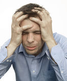 Frustrated. Man with severe headache or very angry and frustrated Stock Image