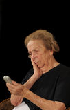 Frustrated. Elderly woman frustrated with an electronic device Stock Photography