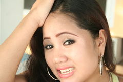 Frustrated. A frustrated asian girl Stock Image
