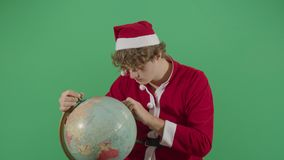 Frustrated Adult Man Santa Claus Searching The Globe