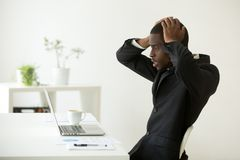 Frustrated African American reading company bankruptcy news stock image