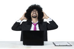 Frustrated Afro businessman with laptop Royalty Free Stock Photo