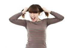 A frustrated and angry girl pulling her hair Stock Photography