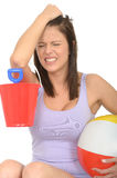 Frustrated Angry Stressed Young Woman on Holiday Holding a Bucket and Spade with Beach Ball Stock Images