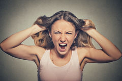 Frustrated angry woman pulling hair out yelling screaming royalty free stock photos