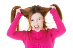 Frustrated and angry woman pulling her hair Royalty Free Stock Images
