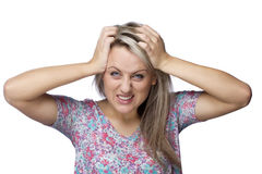 Frustrated and angry woman is pulling her hair. Image of frustrated and angry young woman is pulling her hair over white background Royalty Free Stock Image