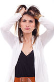 Frustrated and angry woman pulling her hair. Stock Images