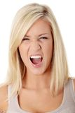 A frustrated and angry woman is screaming Stock Photography
