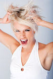 Frustrated angry woman tearing at her hair Royalty Free Stock Photo