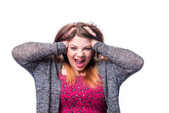 Frustrated and angry woman. A very frustrated and angry woman pulling her hair Royalty Free Stock Photo
