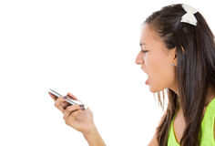 frustrated angry young woman yelling on her phone Royalty Free Stock Images