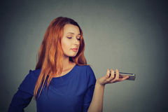 Frustrated annoyed upset woman with mobile phone royalty free stock images