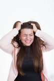 Frustrated annoyed woman tearing hair out Stock Image