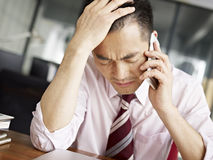 Frustrated asian business person Stock Images