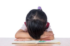 Frustrated Asian Chinese girl with head down on the table Stock Image