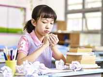 Frustrated asian elementary school girl Stock Photography