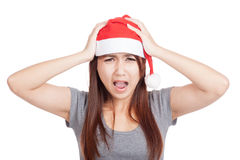 Frustrated Asian girl with red santa hat Royalty Free Stock Image