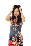 Frustrated Asian young woman screaming pulling her hair Stock Images