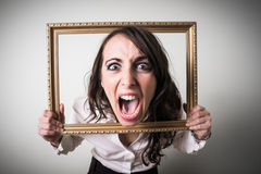 Frustrated beautiful young businesswoman throuch ledge Royalty Free Stock Photography