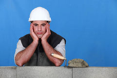 A frustrated bricklayer Royalty Free Stock Image