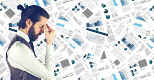 Frustrated business man against document backdrop. Digital composite of Frustrated business man against document backdrop Stock Photos